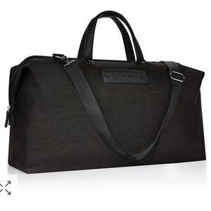 John Varvat black duffel bag